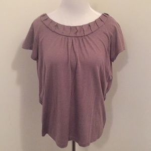 Loft top with gathered and detailed neckline.